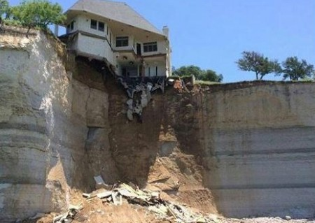 House Falling Off Cliff