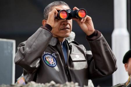 Barack Obama uses binoculars - Public Domain