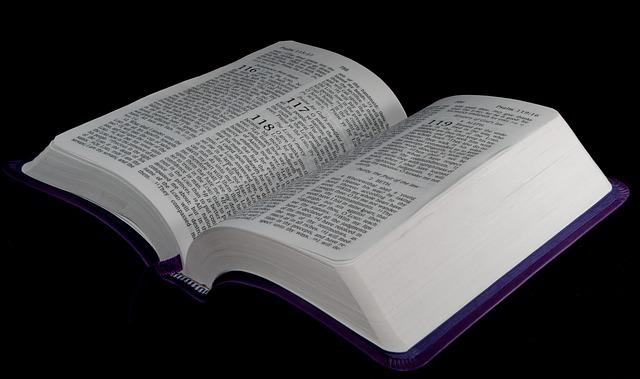 Bible On A Black Background - Public Domain