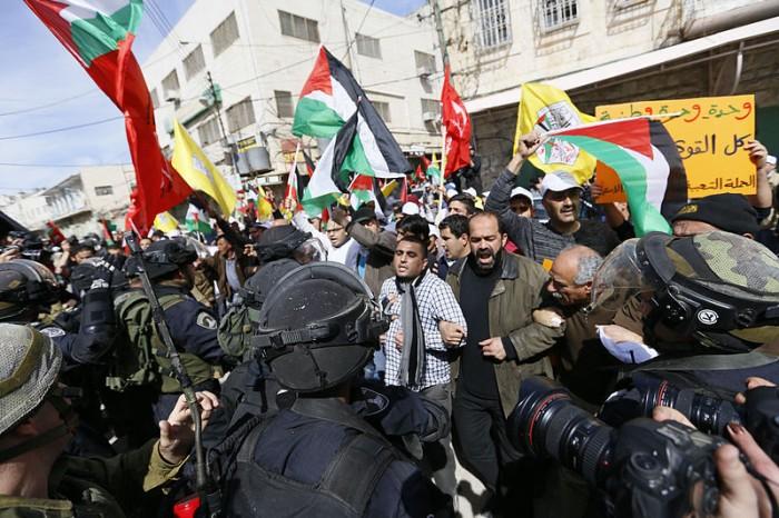 Palestinians - Photo by Mustafa Bader