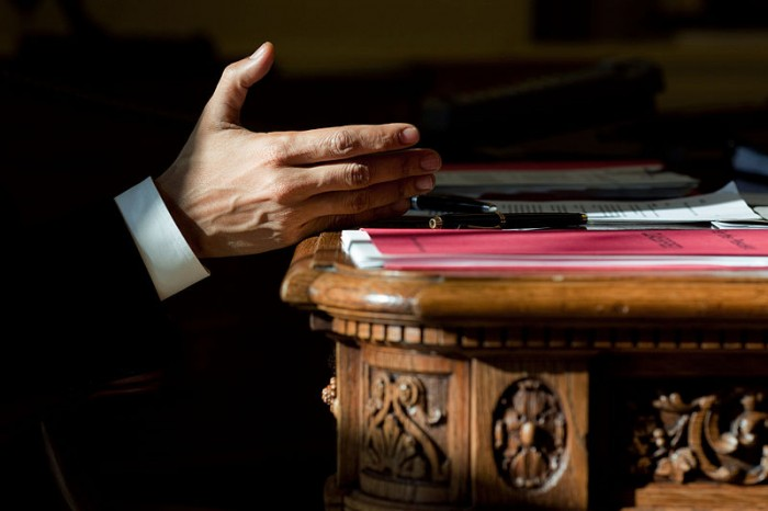 Barack Obama With His Hand On The Resolute Desk