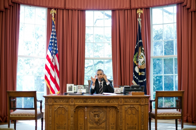 Barack Obama talks on the phone with Prime Minister Benjamin Netanyahu of Israel in the Oval Office - Public Domain